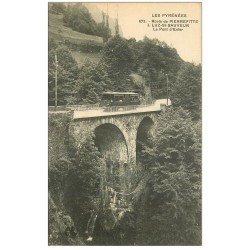 carte postale ancienne 65 ROUTE DE PIERREFITTE à LUZ-SAINT-SAUVEUR. Pont d'Enfer avec Tramway 673