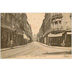 carte postale ancienne 42 ROANNE. Rue du Lycée Café Helvétique et de l'Union vers 1919