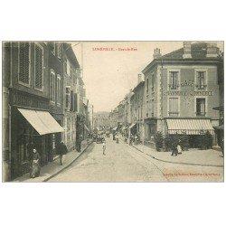 carte postale ancienne 54 LUNEVILLE. Grande Rue Brasserie du Commerce 1916