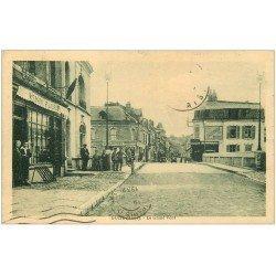 carte postale ancienne 02 GUISE. Cycliste sur Grand Pont 1932. Tabac Fluet