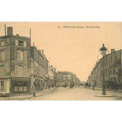 carte postale ancienne 79 NIORT. La Rue de la Gare Café Restaurant Tainon et Coiffeur