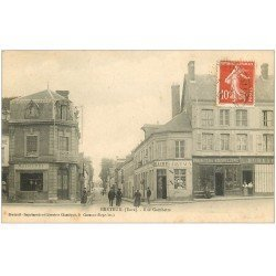 carte postale ancienne 27 BRETEUIL. Rue Gambetta 1910 Bourrelerie Graineterie