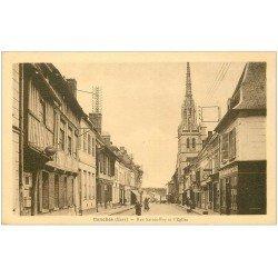 carte postale ancienne 27 CONCHES. Rue Sainte Foy Eglise et Pâtisserie