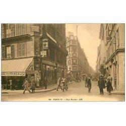 carte postale ancienne 75 PARIS 09. Rue Richer. Tabac des Folies. Agent de Police