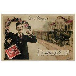 carte postale ancienne 61 LAIGLE L'AIGLE. Carte montage personnage et Train 1910. Papier glacé