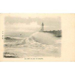 14 LA NORMANDIE. Le Phare sur la Jetée jour de Tempête vers 1900