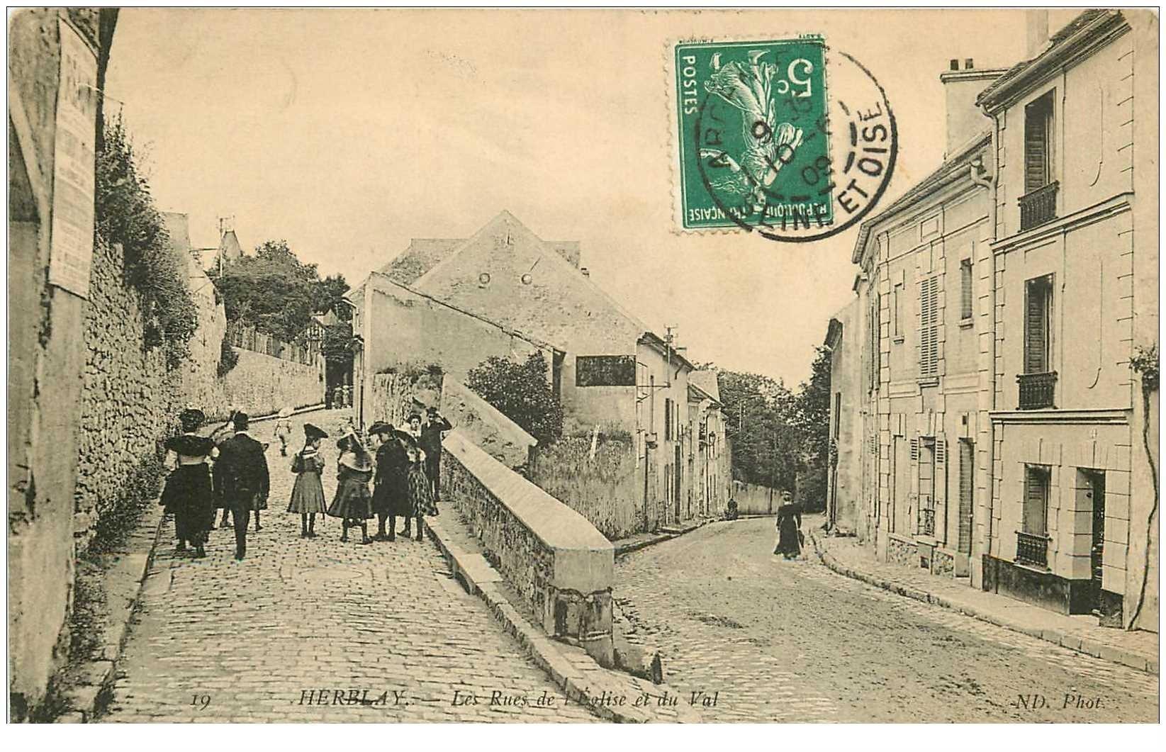 carte postale ancienne K. 95 HERBLAY. Rues de l'Eglise et du Val 1909