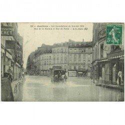 carte postale ancienne Inondation et Crue de 1910. ASNIERES 92. Rue de la Station et de Paris