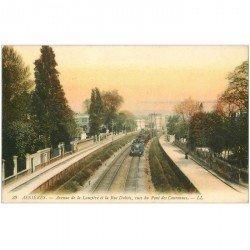 carte postale ancienne 92 ASNIERES SUR SEINE. Train entre Avenue de la Lauzière et rue Dubois