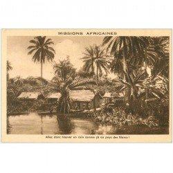 carte postale ancienne COTE D'IVOIRE. Un Village animé des Missions Africaines