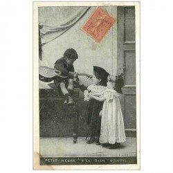 carte postale ancienne MUSIQUE ET MUSICIENS. La Guitariste petit nègre 1905