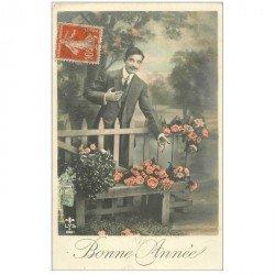 carte postale ancienne BONNE ANNEE. Fleurs sur un banc