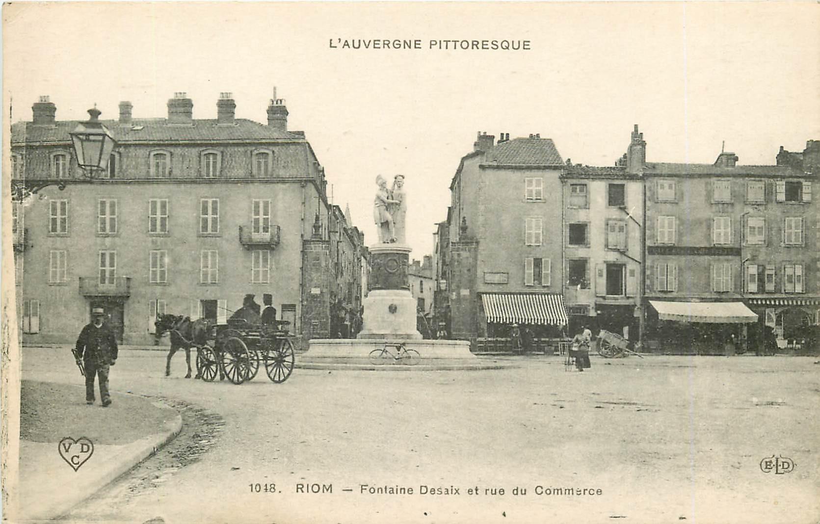WW 63 RIOM. Fontaine Desaix et rue du Commerce