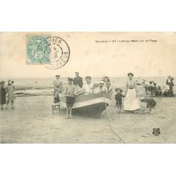 14 LUC-SUR-MER. La Plage avec animation sur une barque 1905
