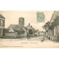 77 LARCHANT. La Grande Rue avec cycliste vers 1906