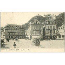 carte postale ancienne 63 LA BOURBOULE. La Place 1911 Epicerie Confiserie et Hôtel de l'Europe