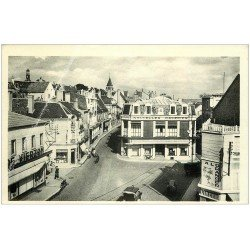 carte postale ancienne 18 VIERZON. Rue Brunet. Nouvelles Galeries et Laverie à l'Oranger.