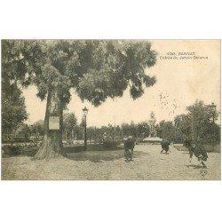 carte postale ancienne 03 GANNAT. Jardin Delarue, Enfants jouant aux billes 1915